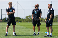 (L-R) manager Graham Potter, Bjorn Hamberg, assistant coach and Billy Reid, assistant manager speak on the pitch during the Swansea City Training Session at The Fairwood Training Ground, Wales, UK. Tuesday 03 July 2018