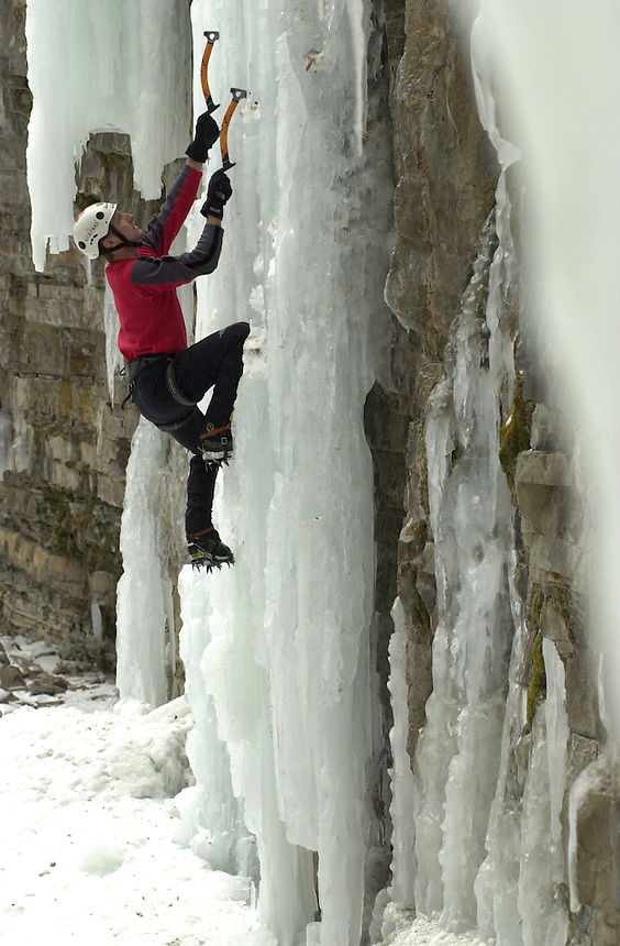 An ice climber ascends a waterfall at Cascade Creek, between Durango and Silverton, Colorado in January 2003.