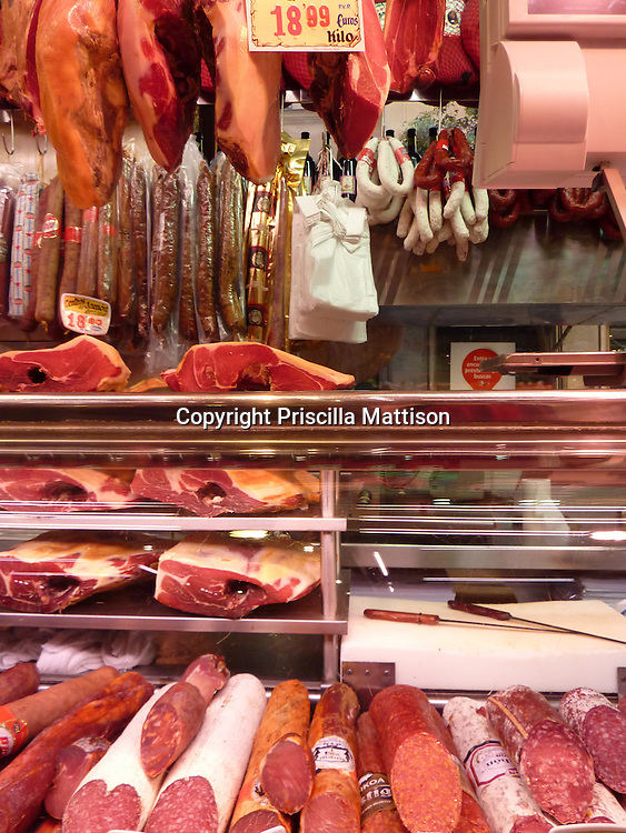 Madrid, Spain - October 20, 2011:  An assortment of meats is displayed in a store.