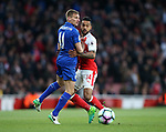 Arsenal's Theo Walcott tussles with Leicester's Marc Albrighton during the Premier League match at the Emirates Stadium, London. Picture date: April 26th, 2017. Pic credit should read: David Klein/Sportimage