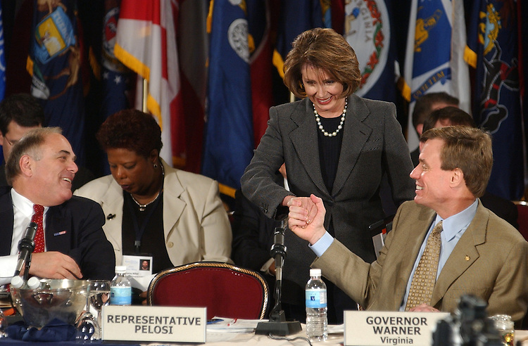 House Minority Leader Nancy Pelosi, R-Calif., greets Gov. Mark Warner, D-Va., as Gov. Ed Rendell, D-Pa., looks on after giving a speech at the National Governors Association Winter Meeting.  Pelosi and fellow guest speaker Sen. Bill Frist, discussed critical state issues in the second session of the 108th Congress.