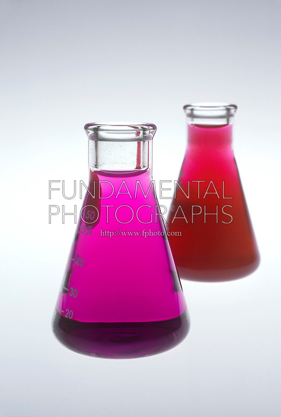 POTASSIUM PERMANGANATE IN WATER<br /> Two Solutions Compared<br /> Two solutions of potassium permanganate are compared. In the flask at left, potassium permanganate solution has been recently mixed, compared with the flask at right of a potassium permanganate solution that has been standing for a period of time.