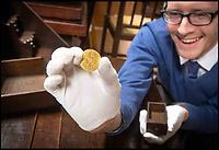 Auctioneer finds £3000 gold coin in £80 desk.