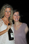 """General Hospital Laura Wright """"Carly"""" poses with fan Kathleen at a Wine Tasting for Standing Sun Wines on August 11, 2012 at MaGooby's Joke House in Timonium, Maryland. The fans got a chance to takes all the various wines, a Q&A, photos, autographs. L(Photo by Sue Coflin/Max Photos)"""
