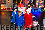 Caoimhe, Liam & Michael Fitzgerald from Meenahorna, Duagh with Santa Claus at Noonan's Lights.