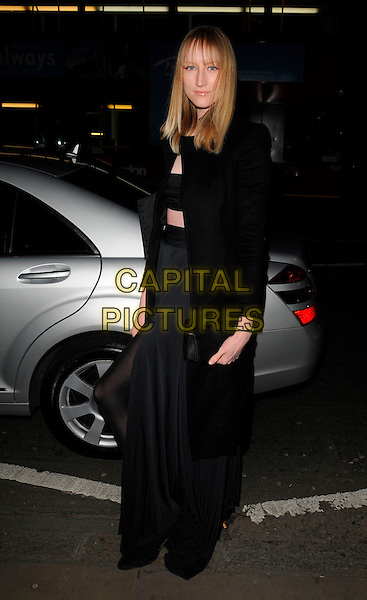 JADE PARFITT.The Dom Perignon Vintage Champagne party, The Landau restaurant, London, England..February 26th, 2008.full length black coat jacket dress clutch bag purse .CAP/CAN.©Can Nguyen/Capital Pictures.