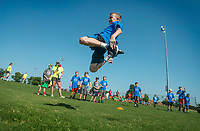 NWA Democrat-Gazette/BEN GOFF @NWABENGOFF<br /> Austin Ireland, 12, of Bentonville competes in the long jump Tuesday, June 5, 2018, during Bentonville's Camp Memorial at Memorial Park. The five-day camp session for ages 8-12 is part of Bentonville Parks and Recreation's Camp Bentonville program. Campers split into teams to compete in a variety of summer sports and activities each day, including soccer, basketball, scavenger hunts and swimming.