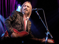 02 October 2017 - Tom Petty, whose Florida-bred quintet the Heartbreakers was one of the defining arena-rock acts of the 1970s with hits like &ldquo;Breakdown,&rdquo; has died after suffering a heart attack Sunday at his home. He was 66. American musician, singer, songwriter, multi instrumentalist and record producer. He is best known as the lead singer of Tom Petty and the Heartbreakers, but is also known as a member and co-founder of the late 1980s supergroup the Traveling Wilburys (under the pseudonyms of Charlie T. Wilbury Jr. and Muddy Wilbury), and his early band Mudcrutch. Petty has recorded a number of hit singles with the Heartbreakers and as a solo artist, many of which are mainstays on adult contemporary and classic rock radio. In 2002, Petty was inducted into the Rock and Roll Hall of Fame. File Photo: April 29, 2012 - Alpharetta, GA - Superstar rocker Tom Petty brough his tour to the Verizon Wireless Amphitheater in Alpharett, GA, where he performed his hits for a sold-out crowd of enthusiastic fans. <br /> CAP/ADM/DH<br /> &copy;DH/ADM/Capital Pictures