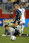 04 September 2004: Taylor Twellman (20), San Jose goalkeeper Jon Conway (bottom), and Jeff Agoos (behind) watch Twellman's shot roll wide of the goal in the second half. The San Jose Earthquakes defeated the New England Revolution 1-0 at Gillette Stadium in Foxboro, MA during a regular season Major League Soccer game..