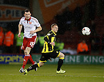 Neill Collins of Sheffield Utd clears the danger from Stuart Beavon of Burton Albion - English League One - Sheffield Utd vs Burton Albion - Bramall Lane Stadium - Sheffield - England - 1st March 2016 - Pic Simon Bellis/Sportimage