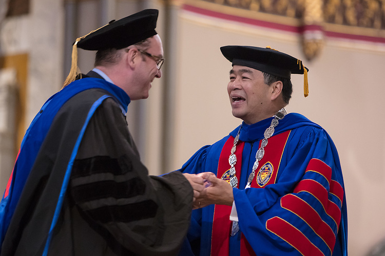 Tom Judge, chaplain, receives a Spirit of DePaul award from A. Gabriel Esteban, Ph.D., president of DePaul University, during the 120th DePaul University Convocation on Thursday, August 31, 2017, at St. Vincent de Paul Parish Church. Dr. Esteban and Marten denBoer, provost, provided remarks, and many faculty and staff were recognized with annual awards and recognitions Teaching, Spirit of Inquiry, Excellence in Public Service, Vincent de Paul Professorship, Spirit of DePaul, Staff Quality Service, Gerald Paetsch Academic Advising and faculty promotion and tenure. (DePaul University/Jeff Carrion)