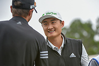 HaoTong Li (CHN) visits on the tee on 1 during day 3 of the Valero Texas Open, at the TPC San Antonio Oaks Course, San Antonio, Texas, USA. 4/6/2019.<br /> Picture: Golffile | Ken Murray<br /> <br /> <br /> All photo usage must carry mandatory copyright credit (&copy; Golffile | Ken Murray)
