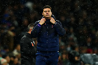9th November 2019; Tottenham Hotspur Stadium, London, England; English Premier League Football, Tottenham Hotspur versus Sheffield United; Tottenham Hotspur Manager Mauricio Pochettino adjusts his collar - Strictly Editorial Use Only. No use with unauthorized audio, video, data, fixture lists, club/league logos or 'live' services. Online in-match use limited to 120 images, no video emulation. No use in betting, games or single club/league/player publications