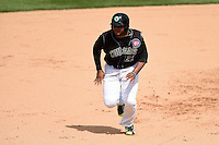Kane County Cougars outfielder Yasiel Balaguert (22) running the bases during a game against the Quad Cities River Bandits on August 20, 2014 at Third Bank Ballpark in Geneva, Illinois.  Kane County defeated Burlington 7-3.  (Mike Janes/Four Seam Images)
