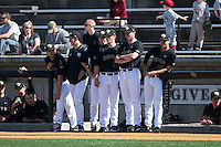 Members of the Wake Forest Demon Deacons watch the action from the top step of the dugout during the game against the Florida State Seminoles at David F. Couch Ballpark on April 16, 2016 in Winston-Salem, North Carolina.  The Seminoles defeated the Demon Deacons 13-8.  (Brian Westerholt/Four Seam Images)