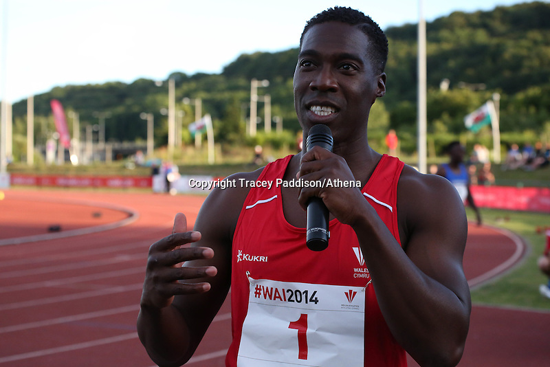 Tuesday 15th July 2014<br /> Pictured: Christian Malcolm<br /> RE: Welsh sprinter Christian Malcolm, holding and speaking into a microphone after running his last race on home soil at the Welsh Athletics International in the Cardiff International Sports Stadium, South Wales, UK.