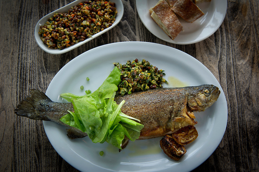 A whole North Carolina roasted trout with olive-preserved lemon relish, and a dish of Sea Island red peas and farro at Cakes & Ale, photographed for Choice Tables on Friday, April 22, 2011 in Decatur. GA.  (Rich Addicks/Photographer) 10110950A