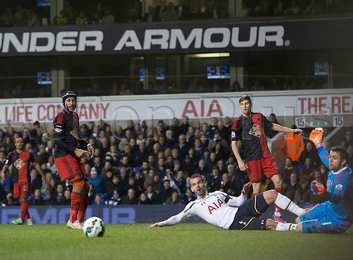 04.03.2015.  London, England. Barclays Premier League. Tottenham Hotspur versus Swansea City. Tottenham Hotspur's Roberto Soldado can only watch as the ball speeds past him.