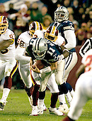 Landover, MD - December 18, 2005 -- Dallas Cowboy quarterback Drew Bledsoe (11) is sacked by Redskins linebacker Chris Clemons (58),left, and cornerback Walt Harris (27), right.  The Redskins won the game 35 - 7..Credit: Ron Sachs / CNP