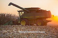63801-06716 John Deere combine harvesting corn at sunset, Marion Co., IL