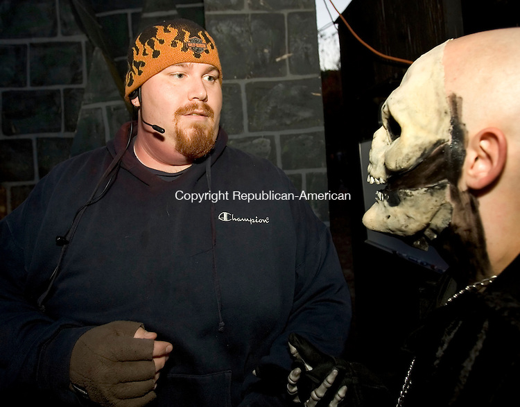 BRISTOL, CT-14 OCTOBER 2006-101406JS11-Nicholas Napp, left, of Watertown, talks with fellow actor A. J. Pelitier, right, prior to the opening of the Haunted Graveyard at Lake Compounce in Bristol. Napp is occasionally a costumed character in the Haunted Graveyard. <br />  -Jim Shannon Republican-American