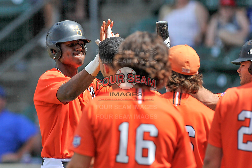 Center fielder Kyle Lewis (20) of the Mercer Bears is congratulated after scoring a run in a SoCon Tournament game against Western Carolina on Saturday, May 28, 2016, at Fluor Field at the West End in Greenville, South Carolina. Mercer won, 9-8. (Tom Priddy/Four Seam Images)