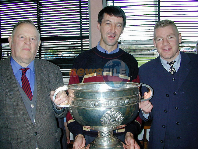Kevin McConnell, player with the Meath '49 team, Willie Cribben, principal Castletown National School with the Sam Maguire on Monday..Picture Paul Mohan Newsfile