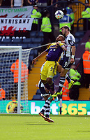 Pictured L-R: Mid air battle for a header against Ashley Williams of Swansea and Shane Long of West Brom. Sunday 01 September 2013<br />
