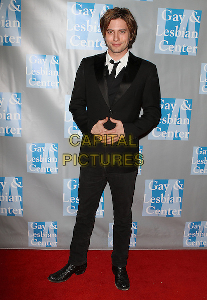 "JACKSON RATHBONE.L.A. Gay & Lesbian Center's ""An Evening With Women"" held at The Beverly Hilton Hotel, Beverly Hills, California, USA..April 16th, 2011.full length  hands black suit.CAP/ADM/KB.©Kevan Brooks/AdMedia/Capital Pictures."