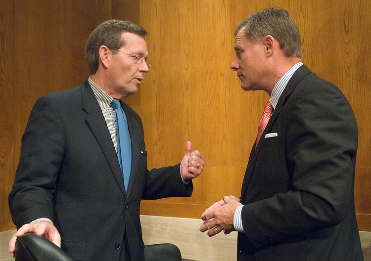 HHS Secretary Michael Leavitt speaks with Sen. Richard Burr, R-N.C., before the start of the Senate Health, Education, Labor and Pensions Committee hearing on food safety on Tuesday, Dec. 4, 2007.