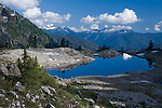 Mount Baker-Snoqualmie National Forest, WA<br /> Lake Ann in the glacial hanging valley above the distant peaks of the North Cascades