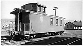 D&amp;RGW long caboose #0540 in Durango with section house in background.<br /> D&amp;RGW  Durango, CO  8/9/1940
