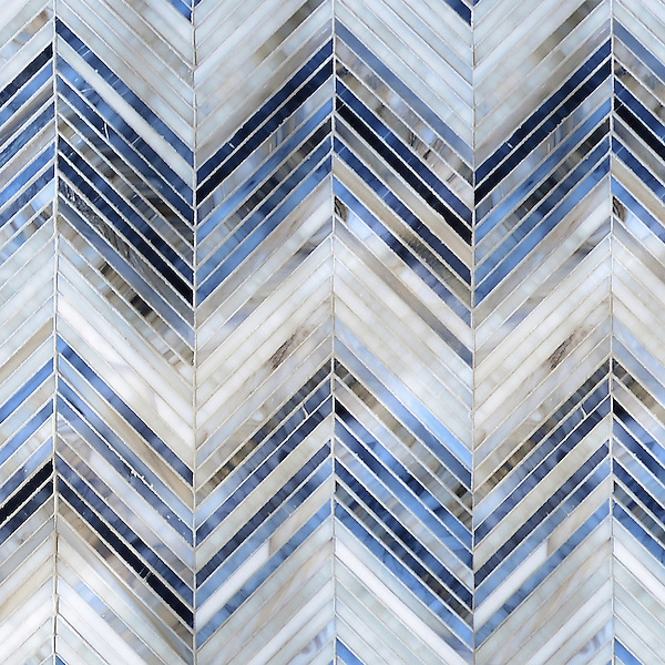Ombre Chevron, a jewel glass mosaic, shown in Lavastone, Zircon, and Alabaster, is part of the Ikat Collection by New Ravenna.