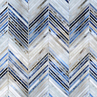Ombre Chevron, a jewel glass mosaic, shown in Lavastone, Zircon, and Alabaster.<br />