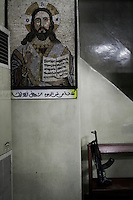 The AK-47 of a Free Syria Army soldier rests on a pulpit next to an image of Jesus Christ at the church of St. Anthony of Padua in the predominantly Christian village of Halassamiya. As the army began pushing through the mountains that surround the Aleppo/Latakia highway, the Free Syria Army successfully repelled the loyalist forces and took control of the area surrounding the town of Halassamiya. Today, militants with links to Al-Qaeda in Iraq have made incursions into this largely abandoned city. The Jesuit priest who held mass in this church, father Paolo Dall'Oglio was shot dead by islamic militants in 2013.