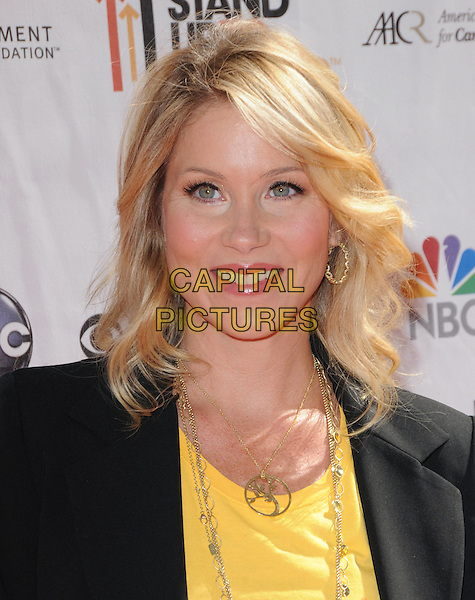 CHRISTINA APPLEGATE .at Stand Up to Cancer held at Sony Picture Studios in Culver City, California, USA, September 10th 2010.     .portrait headshot smiling gold necklace  black yellow .CAP/RKE/DVS.©DVS/RockinExposures/Capital Pictures.