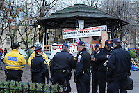November 23, 2011, Toronto Police deployed in significant numbers this morning, beginning the process of evicting the Occupy Toronto tent camp from St. James Park.  Here, police are seen in small groups in the area of the park band shell.