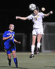 Massapequa No. 11 Hope Breslin, right, heads a ball away from West Islip No. 12 Alyssa Gillespie during the first half of the varsity girls' soccer Class AA Long Island Championship at Adelphi University on Saturday, November 7, 2015. Massapequa went to halftime leading 1-0.<br /> <br /> James Escher