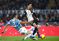 Football, Serie A: S.S. Lazio - Juventus Olympic stadium, Rome, December 7, 2019. <br /> Juventus' Cristiano Ronaldo (r) scores in spite of Lazio's Luis Felipe (l) during the Italian Serie A football match between S.S. Lazio and Juventus at Rome's Olympic stadium, Rome on December 7, 2019.<br /> UPDATE IMAGES PRESS/Isabella Bonotto
