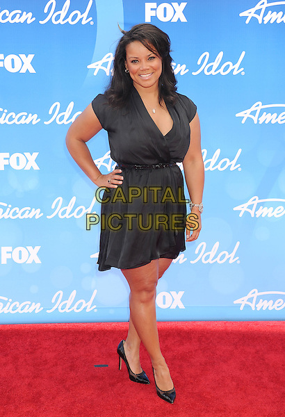 "Kimberley Locke.arriving at FOX's ""American Idol"" Grand Finale at Nokia Theatre L.A. Live in Los Angeles, California, USA,.May 16th 2013..full length black dress hand on hip .CAP/ROT/TM.©Tony Michaels/Roth Stock/Capital Pictures"