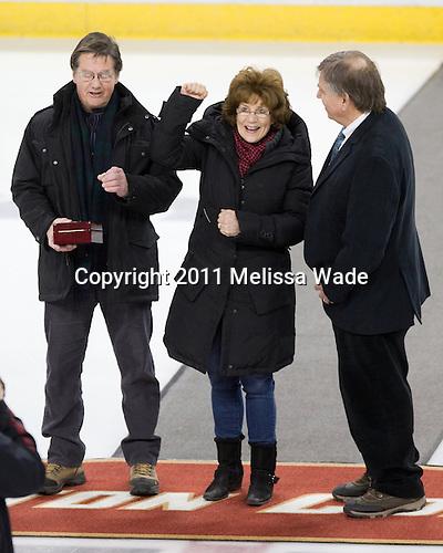 Raymond and Linda Davis, parents of Boston College's Lisa Davis, with Joe Bertagna - The Boston College Eagles defeated the Harvard University Crimson 3-1 to win the 2011 Beanpot championship on Tuesday, February 15, 2011, at Conte Forum in Chestnut Hill, Massachusetts.
