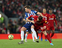 30th November 2019; Anfield, Liverpool, Merseyside, England; English Premier League Football, Liverpool versus Brighton and Hove Albion; Dale Stephens of Brighton and Hove Albion tussles with Adam Lallana of Liverpool - Strictly Editorial Use Only. No use with unauthorized audio, video, data, fixture lists, club/league logos or 'live' services. Online in-match use limited to 120 images, no video emulation. No use in betting, games or single club/league/player publications