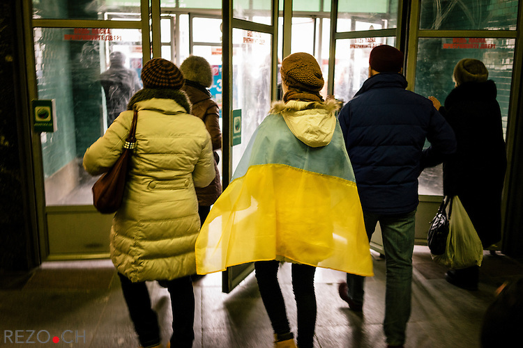 February 22, 2015. Kiev, Ukraine. A young girl coming outof the metro to participate the Decency March organized by the authorities as a part of the commemorations of Euromaidan's victims killed by the police during protests in february 2014. Credits: Niels Ackermann / Rezo.ch