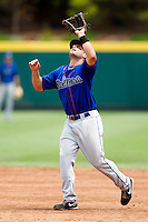 James Cesario (9) of the Tulsa Drillers fields a high fly ball in the infield during a game against the Springfield Cardinals at Hammons Field on June 27, 2011 in Springfield, Missouri. (David Welker / Four Seam Images)