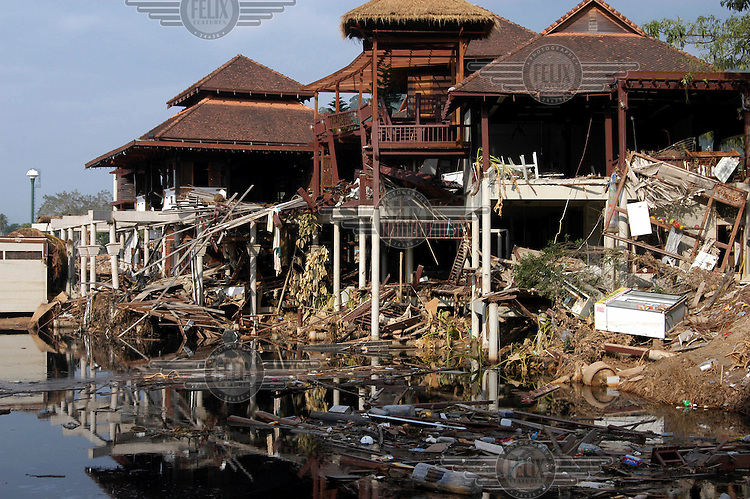 Carnage in Khao Lak, where massive holiday resorts were reduced to rubble by the tsunami..An underwater earthquake measuring 9 on the Richter scale triggered a series of tidal waves which caused devastation when they struck dry land. 12 countries in South Asia were affected by the tsunami, with a combined death toll of over 150,000. In Thailand many of the victims were Western tourists.
