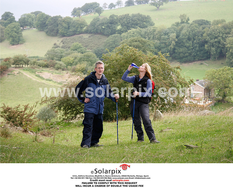"ALL ROUND EXCLUSIVE PICTURES FROM SOLARPIX.COM..ITV's Weather Presenter Siân Lloyd trains in the Welsh.hills around the home she shares with her Liberal.Democrat MP fiance, Lembit Opik. She is taking part in.this year's Mont Blanc Challenge Event, which starts.on 7 September...Sian team's up with 12 friends to raise money for the.Motor Neurone Disease (MND) Association. Sian has a.particular affiliation to this charity because in.April 05 her fiance Lembit Opik's father, died from.the disease...MND is a rapidly progressive, fatal disease that can.affect any adult at any time. The disease leaves.people unable to walk, talk or feed themselves, but.intellect usually remains unaffected...Around 5,000 people in the UK have MND at any one.time.  With no known cure, half die within 14 months.of diagnosis...DATE: 06/09/2006-JOB REF: 2780-PRS..""MUST CREDIT SOLARPIX.COM OR DOUBLE FEE WILL BE CHARGED"""