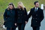 WOODBURY, CT 19 DECEMBER- 121912JS02- A group of mourners comfort leave the Munson-Lovetere Funeral Home in Woodbury on Wednesday during calling hours for Sandy Hook Principal Dawn Hochsprung who died during a deadly shooting last Friday.  .Jim Shannon Republican American