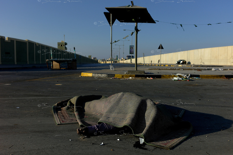 Tripoli, Libya, August 25, 2011.A body lays in the street not far from Khaddafi's Bab Aziziya compound, now entirely in the hands of the rebels.