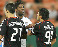 Jaime Moreno #99 of D.C. United confronts Brandon McDonald #14 of the San Jose Earthquakes during an MLS match at RFK Stadium in Washington D.C. on October 9 2010. San Jose won 2-0.