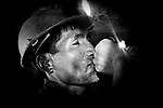 Potosi, Bolivia. A miner drinking raw alcohol during a break. Sometimes the miners even stay inside the tunnel even for 24 hours.